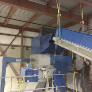 Install conveyor system for grinder