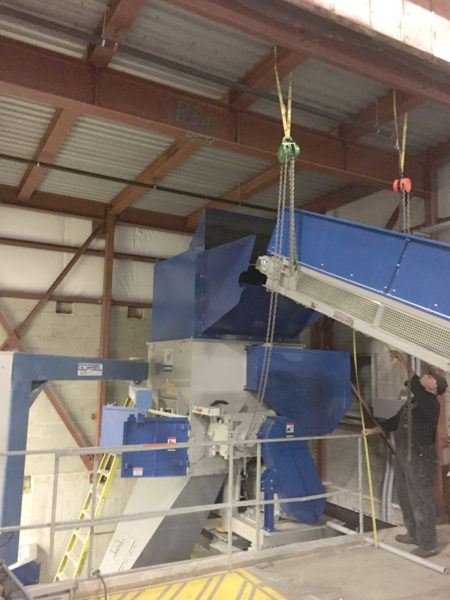 Install conveyor system for grinder