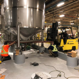 BSM staff installing stainless steel tanks