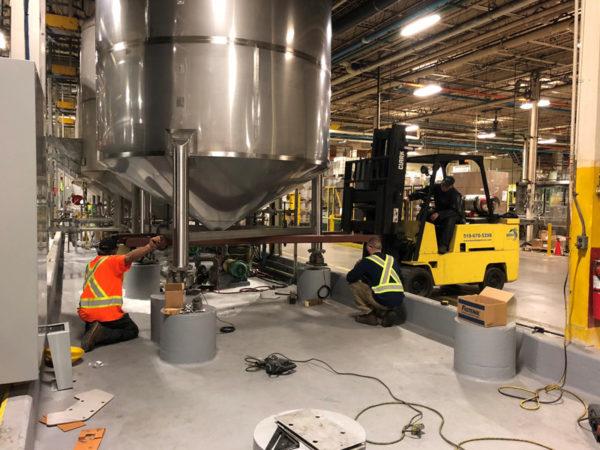 BSM staff installing stainless steel tanks