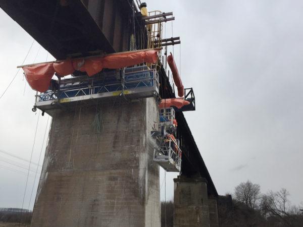 Railway bridge repair, design and install basket supports