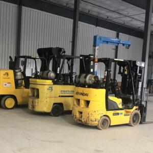 three forklifts (30,000 lb, 15,000 lb & 6,000 lb)